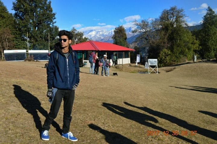 Posing in front of Magpie Camp Chopta